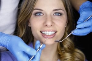 Female patient having dental checkup