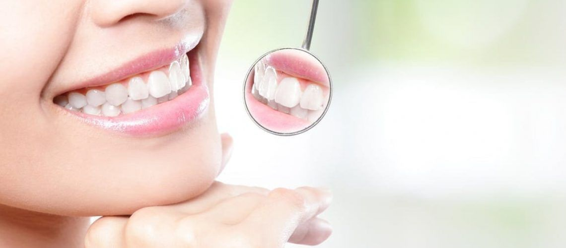 patient checking after teeth whitening